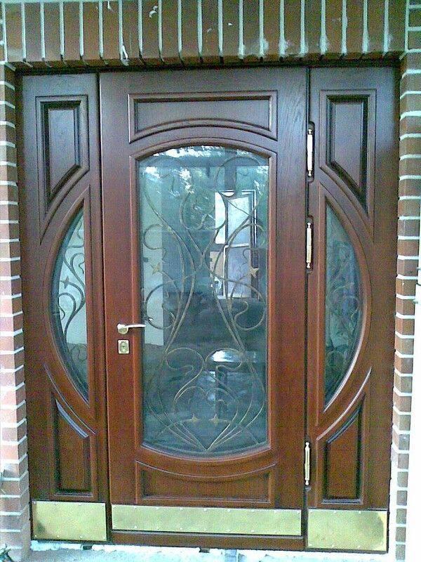 Входные двери кованые со стеклом